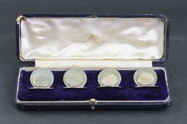 A cased set of four Edwardian silver menu holders, Sampson Mordan & Co, Chester 1908, Rd. No.