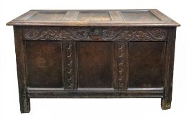 A late 17th century oak coffer, of panelled construction,