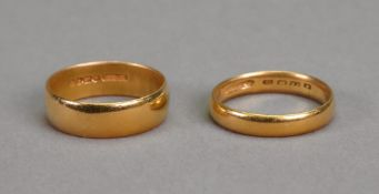 A 22ct gold band ring, Sheffield 1899, ring size Q; and another 22ct gold band ring,