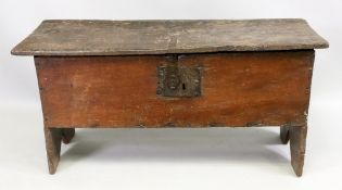 A 17th century oak planked coffer, the moulded hinged top enclosing a compartment,