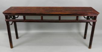 A Chinese side table, the rectangular top above open friezes, on cylindrical legs, 174cm wide x 44.