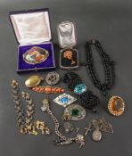 A collection of Victorian and later silver and paste set jewellery,