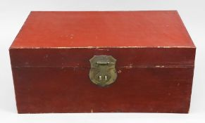 A Chinese red lacquer trunk, with side carrying handle, hasp and shield shape lockplate, 74.