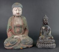 A gilt metal figure of a Buddha,19cm high and a carved wood and painted figure of a seated Buddha,