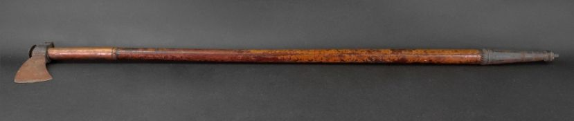 A steel axe, 19th century, the lacquered wooden shaft with the upper part encased in copper,