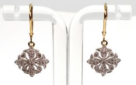 A pair of diamond-set pendant earrings in a stylised geometric floral design,