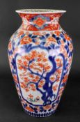 A Japanese Imari vase, Meiji period, painted with panels of birds amongst flowering branches,