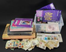 A collection of Great Britain first day covers, stamp postcards,