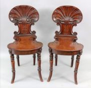 A pair of Regency mahogany hall chairs, in the manner of Gillows,