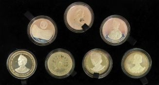 1980 Queen Mother set of seven commemorative silver crowns, cased.