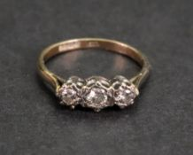 A 9ct gold and three-stone diamond ring, the circular-cut diamonds,