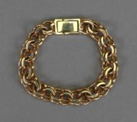 A 9ct gold bracelet of triple fancy link design, on a snap-clasp, length 19cm, 27.