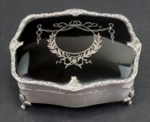 A shaped rectangular silver jewel casket, Mappin & Webb, Birmingham 1913,