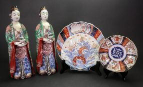 A pair of Japanese Kutani figures of young women, Meiji period,
