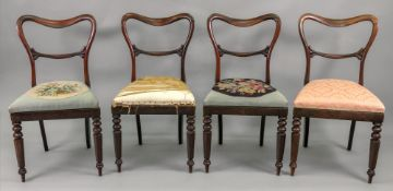 A set of four William IV rosewood balloon back dining chairs, with drop in seats,