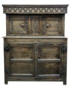 A Jacobean carved oak court cupboard, of panelled construction,