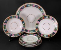 A large Russian circular bowl, a smaller bowl and four plates,