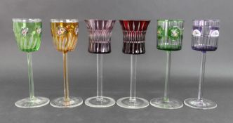 A group of six Austro-German hock glasses, 20th century, the bowls stained in varying colours,