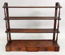 A set of early 19th century mahogany three-tier wall hanging shelves,