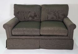 Schumacher, a modern three seater sofa, with grey/green upholstery, on tapering square supports,