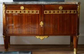 A Louis XVI style ormolu mounted, marble topped, walnut commode, 133cm wide x 88cm high.
