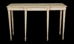 A modern limed oak breakfront side table with single frieze drawer on fluted tapering supports,