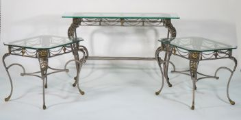 A wrought iron and glass rectangular side table on scrolling claw supports, 120cm wide x 74cm high,