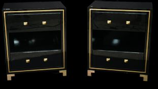 A pair of modern black lacquer two drawer side cabinets with brass inlaid decoration and brass feet,