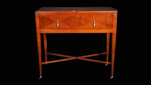 Baker, a modern mahogany single drawer extending side table united by 'X' frame stretcher,