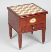A modern inlaid mahogany games table with glass chess set, 41cm wide x 49cm high.