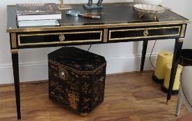A Louis XVI style ormolu mounted, black lacquer two drawer bureau plat, 135cm wide x 78cm high.