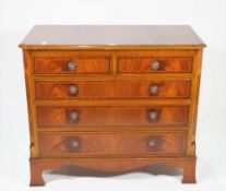 A Regency style mahogany chest of two short and three long graduated drawers, on bracket feet,
