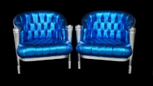 A pair of silver painted tub chairs with button back faux electric blue lizard skin upholstery on