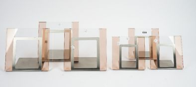 A set of six coloured glass and brushed steel photograph frames,