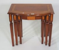 A modern mahogany and faux elm painted bowfront nest of three tables,