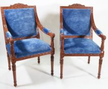 A pair of George III style stained beech framed open armchairs,