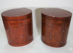 Baker; a pair of modern mahogany oval bedside tables with single drawer, 61cm wide x 71cm high.