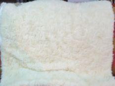 A Bagnaresi Casa white fur throw, 102cm x 197cm.