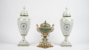 A Thomas Goode porcelain vase and cover, modern, with twin cupid handles and a shell moulded cover,