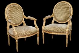 A pair of Louis XVI style giltwood fauteuils on fluted tapering supports, 65cm wide x 103cm, (2).