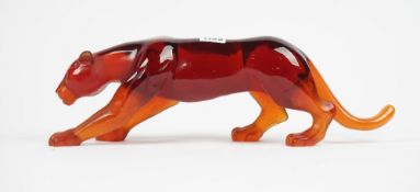 A Daum coloured glass model of a prowling lioness, signed 'Daum France', 43cm.