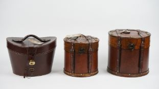 A hand made leather hat box, 35cm wide and two leather bound wooden boxes of circular form, (3).