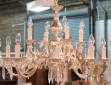 A Victorian style silvered metal twelve branch chandelier with glass drops, 63cm wide.