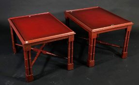 A pair of modern red lacquer side tables, on faux bamboo block supports, 70cm wide x 45cm high, (2).