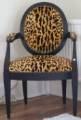 An ebonised faux leopard skin upholstered open armchair, 61cm wide x 96cm high.
