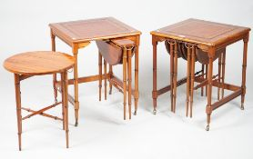 A pair of Regency style mahogany nesting tables, each with two pullout drop flap tables,