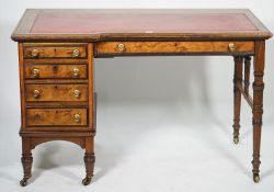 Lamb Manchester; a late Victorian writing desk with one long and four short drawers about the knee,