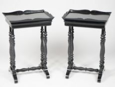 A pair of Victorian style ebonised single drawer side tables on ring turned dual ended supports,