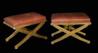 A pair of modern giltwood rectangular 'X' frame footstools with faux ostrich leather upholstery,