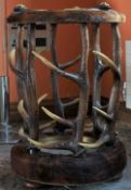 A hide and horn circular stick stand, 43cm diamter x 62cm high.